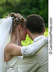 Newly-married couple - The bride with a smile, gently...