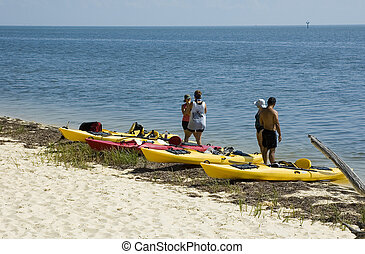 Kayakers on Beach - Kayakers stop for a rest on the beach at...