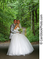 Newly-married couple in park