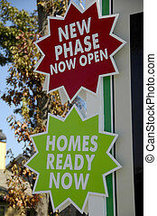 Realty Ads - Red and Green Real-Estate Development Signs