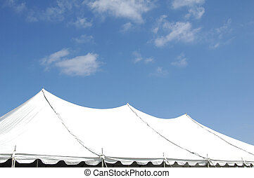 Tent - Top of big white event tent against blue sky.