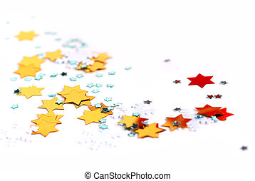 Christmas background of scattered gilittering confetti on...