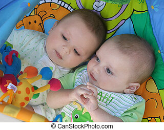 Twins playing - Two baby boys twin brothers playing together