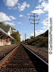 Vanishing Point - Train station and tracks under autumn sky...