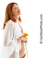 happy pregnant lady with flower over white background