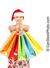 Shopping woman - A pretty woman wearing santa hats carrying...