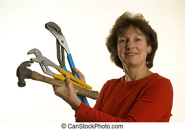 woman with tools - woman middle age with tool channel lock...