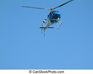 helicopter - police helicopter searching from the skies