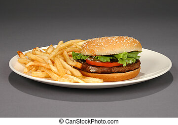 Hamburger and Fries on Neutral Background - Hamburger and...