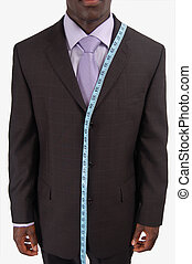 Suit to Fit! - This is an image of a business man, wearing...