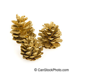 Golden pine cones - Three golden pine cones, isolated on a...