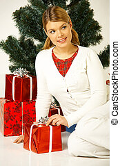 Christmas Gril - Young beautiful woman next to christmas...