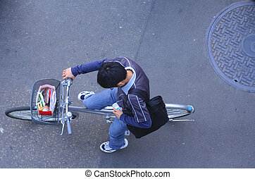 Urban communication - Japanese teen throwing a quick look to...