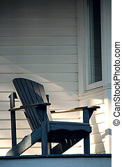Porch chair - Wooden chair on a sunlit porch of a house