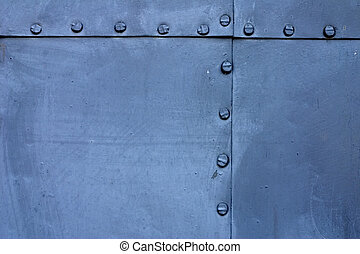 Blue metal plate with rivets