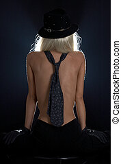 tie games - backlight image of cabaret girl with blue tie on...