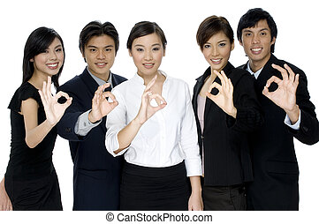 OK Business - A business team give the ok sign on white...