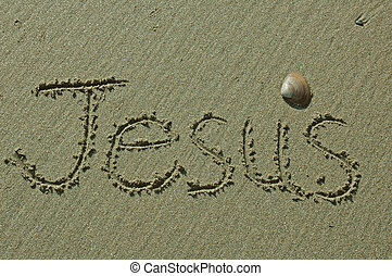 Sand Writing - Jesus - Jesus written in sand with shell...