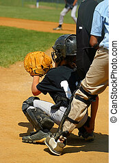 Play Ball - waiting - Baseball catcher with umpire behind...