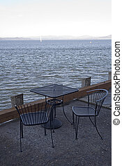 A Table with a View - Photo of a small cafe table on the...