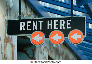 "Rent here - \""Rent here\\\"" sign by apartment complex"