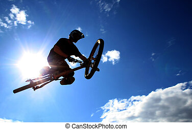 Big Air - A mountainbiker flys across the sky during a...