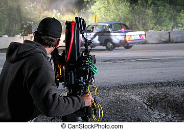 Rolling - A cameraman captures a car crash during filming of...
