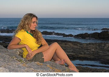 Lonely Girl - Lonely girl sitting at the beach dreaming