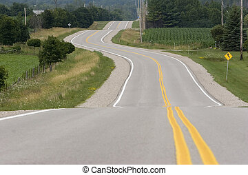 Counrty raod - Horizontal image of windy road meandering...