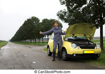 Hitchhiking - Girl with car-trouble trying to hitchhike on...
