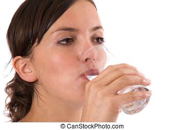 Healthy glass of water - Pretty brunette still sweaty from...