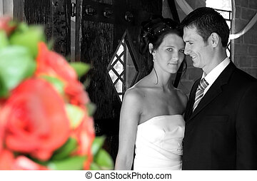 Couple Black Color - Bride and groom standing in chapel...