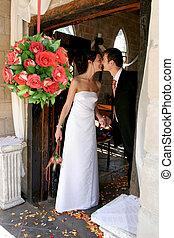 Couple Chapel - Bride and groom standing in chapel doorway...
