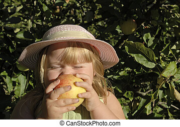 Annie Apple 400 - a young girl eating an apple in the sun