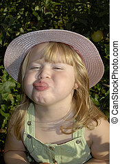 Annie raspberry - young girl sticking her tongue out at the...
