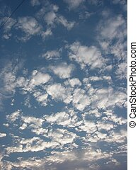 White Clouds - White clouds moving into the sky.