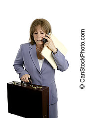 Business Stress - A businesswoman trying to do too many...