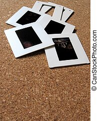 Slides - Photo slides and frames on a board