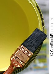 Paint Brush & Paint - Paint brush on open tin of yellow...