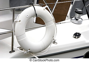 Life Preserver - Life perserver ring tied to railing of...