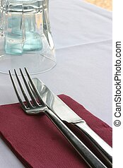 Restaurant Place Set - Close up of cutlery and glass on...