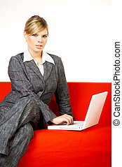 Woman on red couch - Young women is resting on the couch and...
