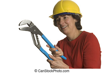woman with tools - woman middle age with tools wearing...
