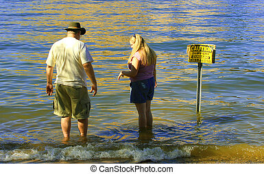 Family Wading - Father and daughter wading in lake