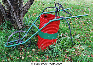 Old-fashioned weed sprayer in a garden