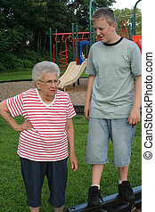 Boy, You\\\'re Short! - Teenage boy standing on edging above...