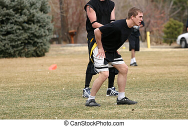 Flag Football - Attractive, physically fit young man playing...