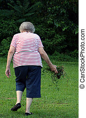 Community Grandma 6 - Senior citizen woman removing weeds...