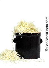 Preparing sauerkraut - Shredded cabbage in the clay jar....