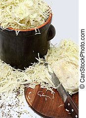 Preparing sauerkraut - Shredded cabbage in the clay jar